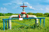 stock photo of gas-pipes  - Gas pipe with a tap valve in the summer - JPG