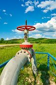 picture of gas-pipes  - Gas pipe with a tap valve in the summer - JPG