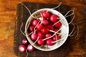 pic of radish  - A bowl of fresh radishes on a wooden background - JPG