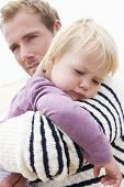 pic of cuddle  - Father Cuddling Young Daughter Outdoors - JPG