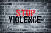 foto of isis  - Stop Violence stencil print on the grunge white brick wall - JPG