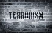 image of isis  - Terrorism stencil print on the grunge white brick wall - JPG