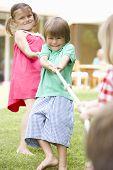 image of tug-of-war  - Children Playing Tug Of War - JPG