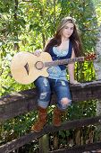 Beautiful Teen Girl with Guitar