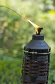 foto of citronella  - Bamboo citronella torches to repell mosquitoes and other insects - JPG
