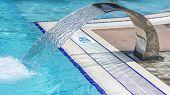 pic of water jet  - Flowing water in swimming pool modern water jet technology - JPG