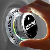 picture of reprocess  - Hand rotating a button and selecting the level of recycling - JPG