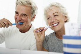 picture of pyjama  - Senior Couple In Bathroom Brushing Teeth - JPG