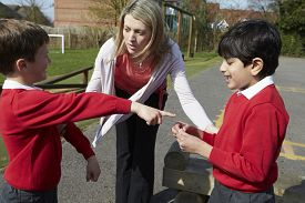 foto of stop fighting  - Teacher Stopping Two Boys Fighting In Playground - JPG