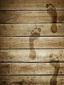 footprint on wood plank