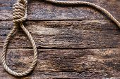 Постер, плакат: Rope With A Slipknot On The Wooden Background