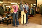 A photo of mannequins displaying colorful girls fashion
