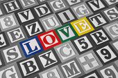 Toy wooden blocks spelling out the word love