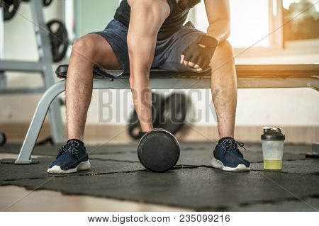 poster of Muscular Man At Gym Taking A Break From Workout Sitting Side Mineral Salt.body And Mind Workout In L