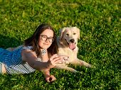 Cheerful Cute Young Woman Taking Selfie And Golden Retriever Dog On Green Meadow. Smilling Brunette  poster