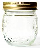 stock photo of jar jelly  - Empty clear glass jelly canning jar with gold lid - JPG