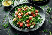 Fresh Juicy Watermelon Arugula Feta Salad With Mint And Orange, Lemon Dressing. Summer Dish. Healthy poster
