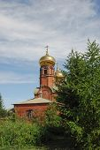 Brick church with gilded dome