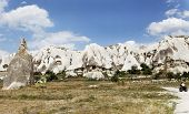 image of riding-crop  - Quad riding in Goreme Cappadocia with backdrop of blue sky and cloudscape volcanic sandstone and limestone rocks cave homes and limestone fairy chimney caves landscape horizontal crop space and copy area - JPG