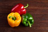 Combination Of Fresh Organic Green, Yellow And Red Pepper On Rustic Wooden Background, Top View, Clo poster