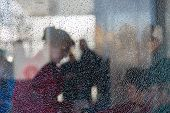 Blurred Silhouettes Of People Behind Broken Glass. Fine Mesh Of Cracks. Creative Background. Female  poster