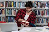 Student Studying At College poster