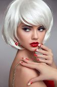 Christmas Red Lips Makeup And Manicured Nails. Beautiful Blonde Girl Closeup Portrait. White Short B poster