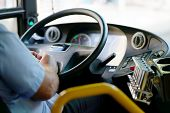 Hands Of Driver In A Modern Bus By Driving.concept - Close-up Of Bus Driver Steering Wheel And Drivi poster
