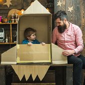 Boy Play With Dad, Father, Little Cosmonaut Sit In Rocket Made Out Of Cardboard Box. Kid Happy Sit I poster