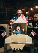 American Cheerful Family With Usa Flags Play With Rocket Made Out Of Cardboard Box. Rocket Launch Co poster