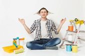 Happy Man In Newspaper Hat Sitting On Floor Meditating, Doing Yoga, Relaxing With Instruments For Re poster