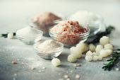 Mix Of Different Salt Types On Grey Concrete Background. Sea Salts, Black And Pink Himalayan Salt Cr poster