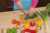 Woman Cooking Healthy Meal In The Kitchen. Cooking Healthy Food At Home. Woman In Kitchen Preparing  poster