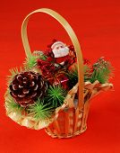 pic of pine cone  - Basket with traditional christmas decorations  - JPG