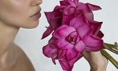 Woman Holding A Pink Flowers Lotus Close-up. Beautiful Girl With Big Exotic Flower Bouquet. Lotus poster