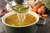 Broth With Carrots, Onions Various Fresh Vegetables In A Pot - Colorful Fresh Clear Spring Soup. Rur poster