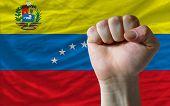 Hard Fist In Front Of Venezuela Flag Symbolizing Power