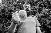 In Playful Mood. Brutal Hipster With Winking Face Having Craft Beer. Man Drinker Holding Beer Mug. B poster