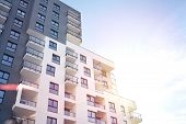 Modern Apartment Buildings On A Sunny Day With A Blue Sky. Facade Of A Modern Apartment Building.gla poster