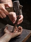 foto of torture  - Detail of the crucifixion of a man on the cross - JPG