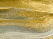 Smooth surface of layered sandstone sediment rock