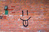 Smile Graffiti On Red Brick Wall