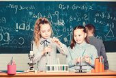 Future Technology And Science Concept. Kids In Classroom With Microscope And Test Tubes. Children St poster