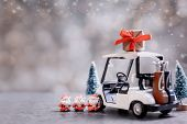 Christmas Decoration With Golf Car And Santa Toy On December. poster