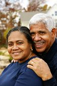 image of senior-citizen  - Happy senior couple together outside their home - JPG