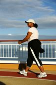 pic of cruise ship  - Woman walking on the deck of a cruise ship