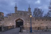 The Old Wooden Gate And Exterior Stone Wall Of The Famous Tower Of London At Sunset In London Englan poster
