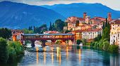 Bridge Ponte degli Alpini at river Brenta Bassano del grappa Italy. Panoramic view at old town with  poster