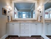 Beautiful bathroom interior with double sinks and marble counter, and large mirrors. poster