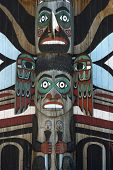 pic of indian totem pole  - Wooden totem pole monumental sculpture carved from large tree - JPG
